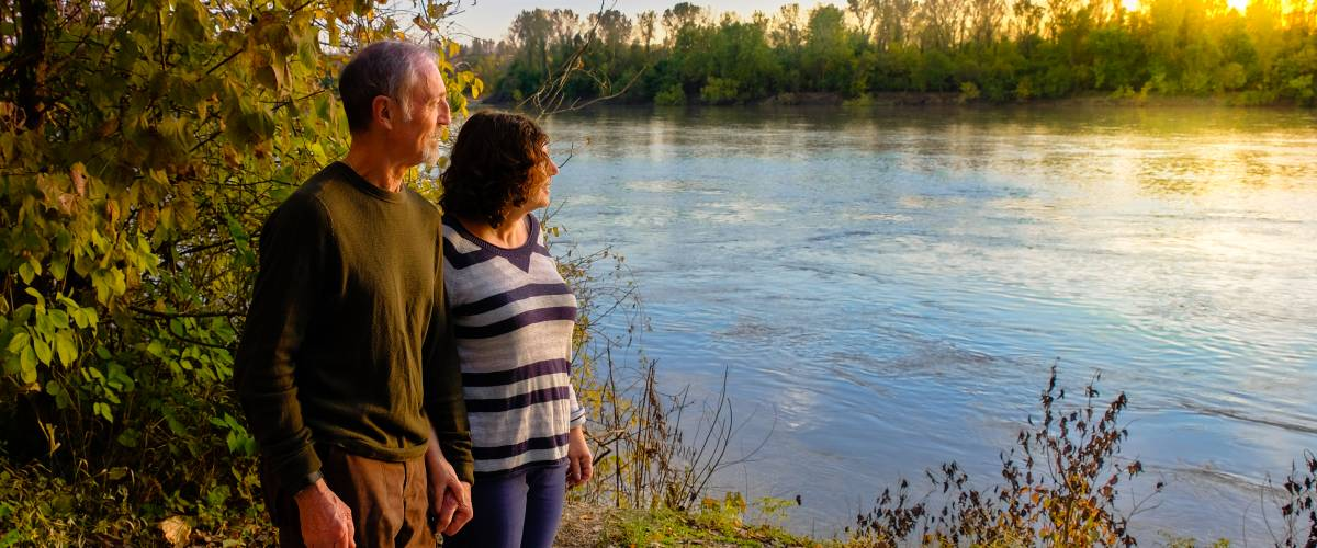 Older couple walking by the water