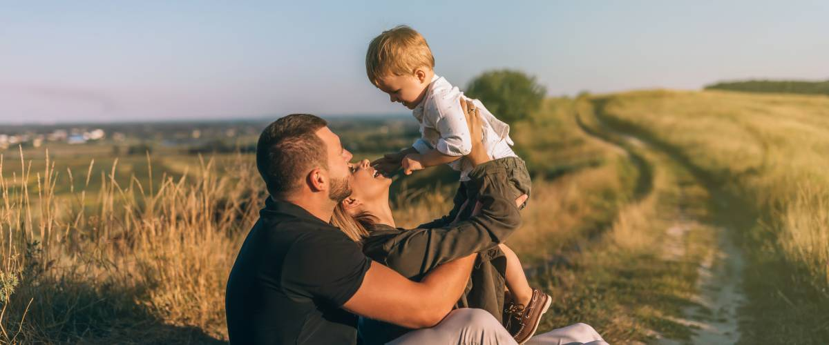 Parents and son in a field