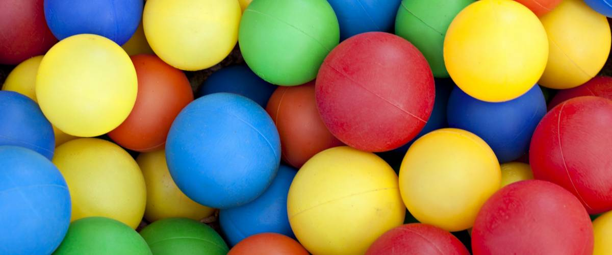 Plastic balls in colors of blue, red, green, yellow and orange