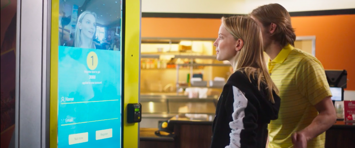 Young couple uses the facial recognition kiosk at CaliBurger.