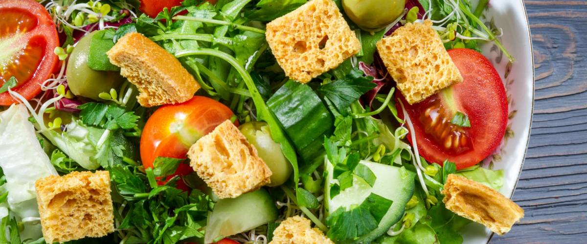 Closeup of healthy Caesar salad with croutons