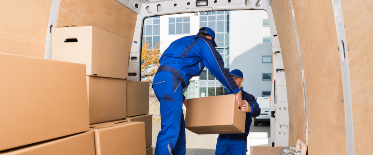 Young movers in van moving boxes