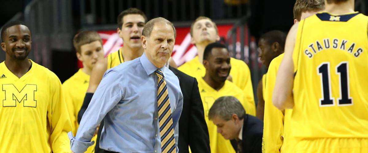 BROOKLYN-DEC 15: Michigan Wolverines head coach John Beilein (R) reacts with players against the West Virginia Mountaineers at Barclays Center on December 15, 2012 in Brooklyn.