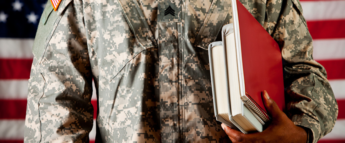 US Army soldier studying books