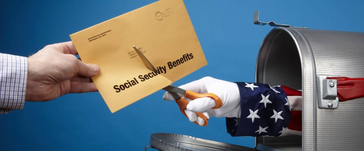Uncle Sam comes out of mailbox to cut social security envelope, includes space for copy