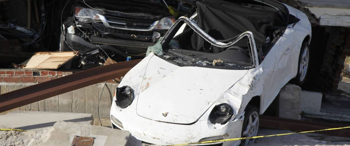 FAR ROCKAWAY, NEW YORK - NOVEMBER 4, 2012: Destroyed luxury car in the aftermath of Hurricane Sandy in Far Rockaway, New York. Image taken 5 days after Superstorm Sandy hit New York