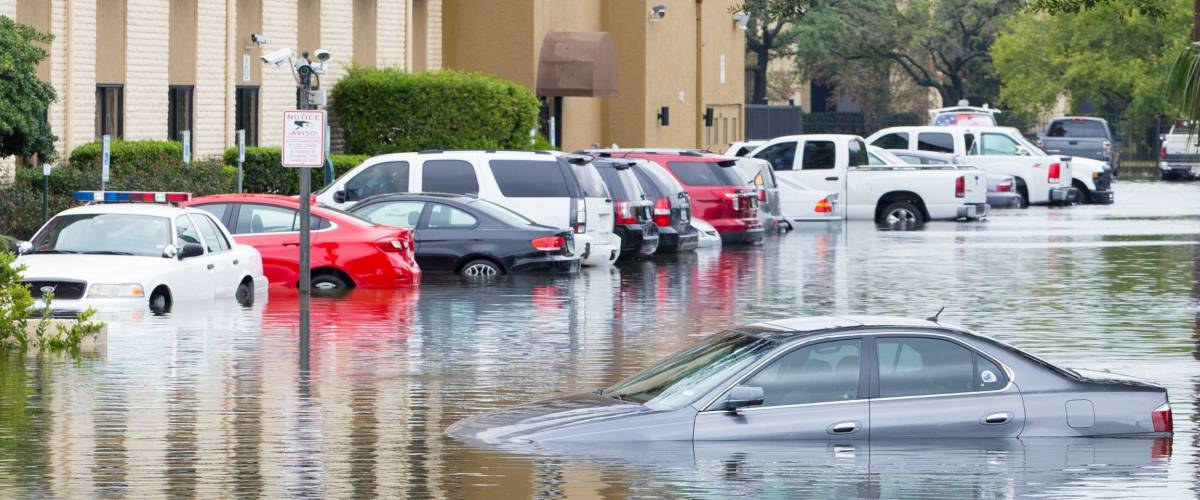 Houston, Texas - August 27, 2017: Cars submerged from hurricane Harvey in Houston, Texas, USA. Heavy rains from hurricane Harvey caused many flooded areas in Houston.