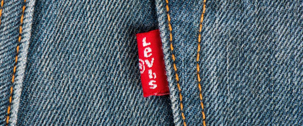 BANGKOK, THAILAND - DECEMBER 09 2014: Close up of the LEVI'S red label on the back pocket of denim jeans. LEVI'S is a brand name of Levi Strauss and Co, founded in 1853.