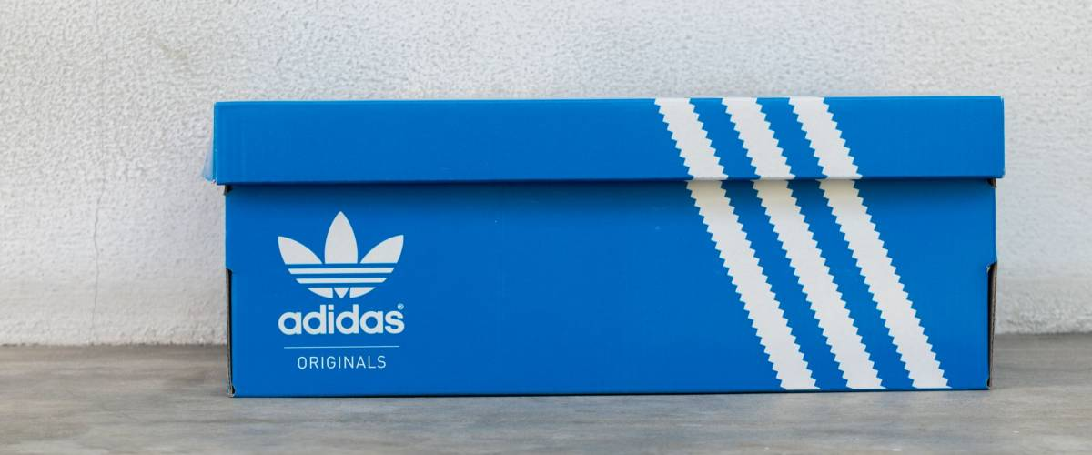 BANGKOK, THAIAND - JULY 2, 2017: Adidas Sign On Adidas Shoe Box. Founded in 1924 is a German multinational corporation that designs and manufactures sports shoes, clothing and accessories.
