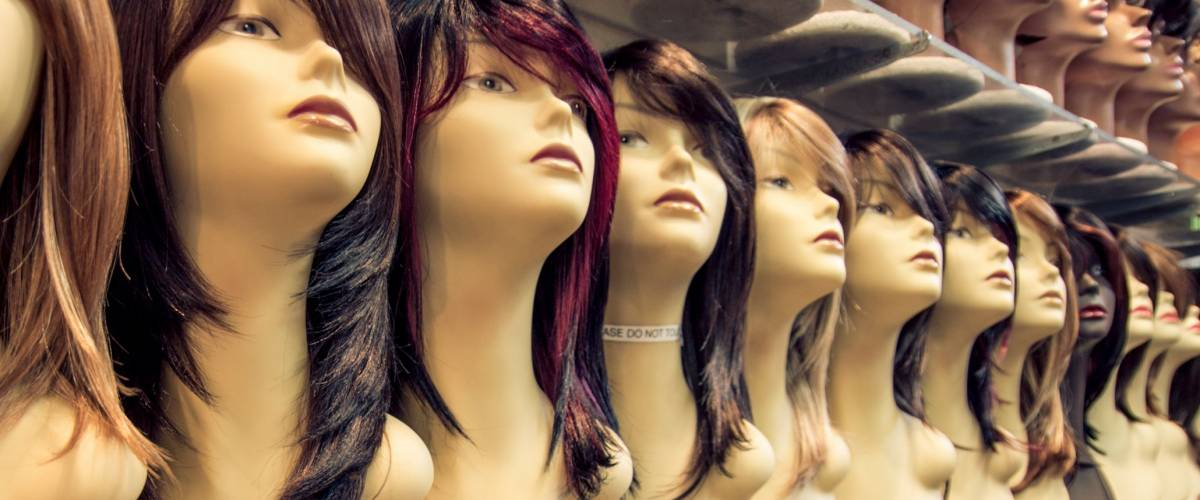Wig shop - Row of mannequins in a peruke shop - Concepts about hairstyle,fashion and beauty