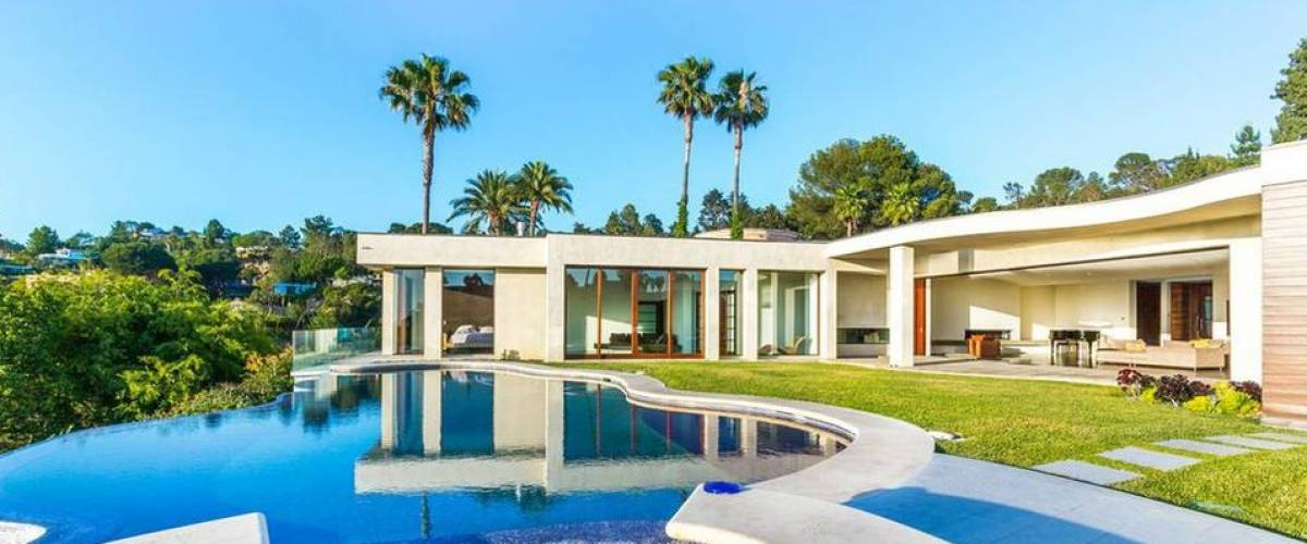 Justin Bieber recently lived in this striking Beverly Hills mansion featured in music videos and commercials.