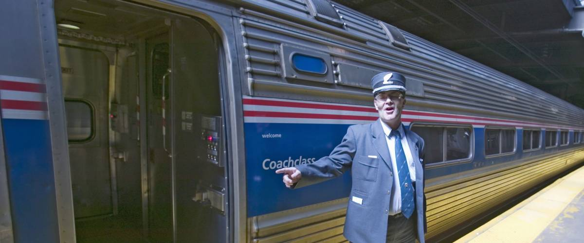 Conductor at Amtrak train platform announces
