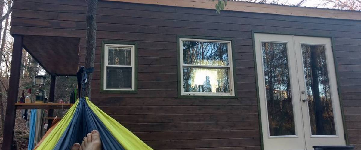 Tony Fishburn admires his new Mighty Small Homes tiny house from the comfort of his hammock.