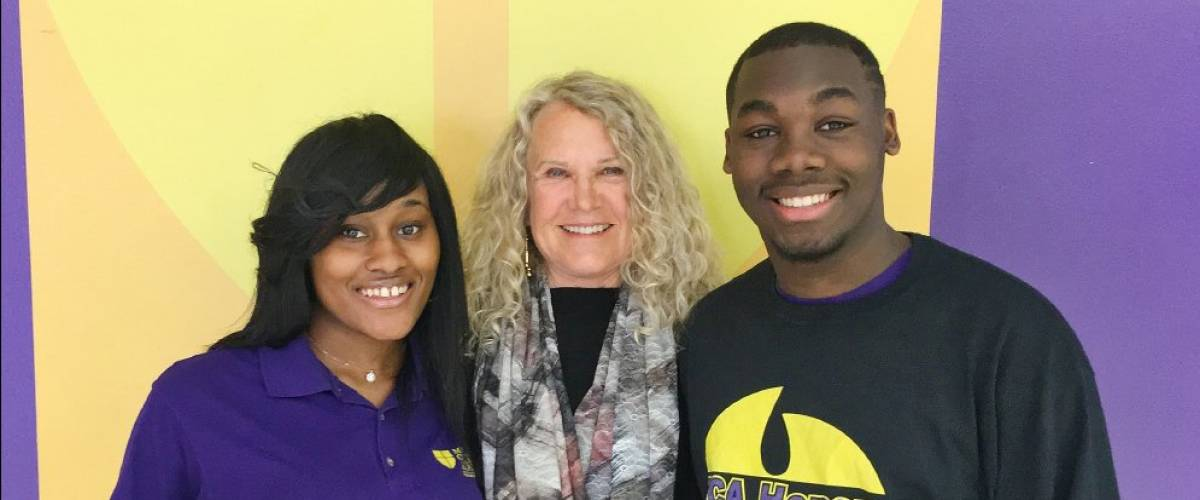 Christy Walton poses with students from the Milwaukee Collegiate Academy on March 28, 2017.