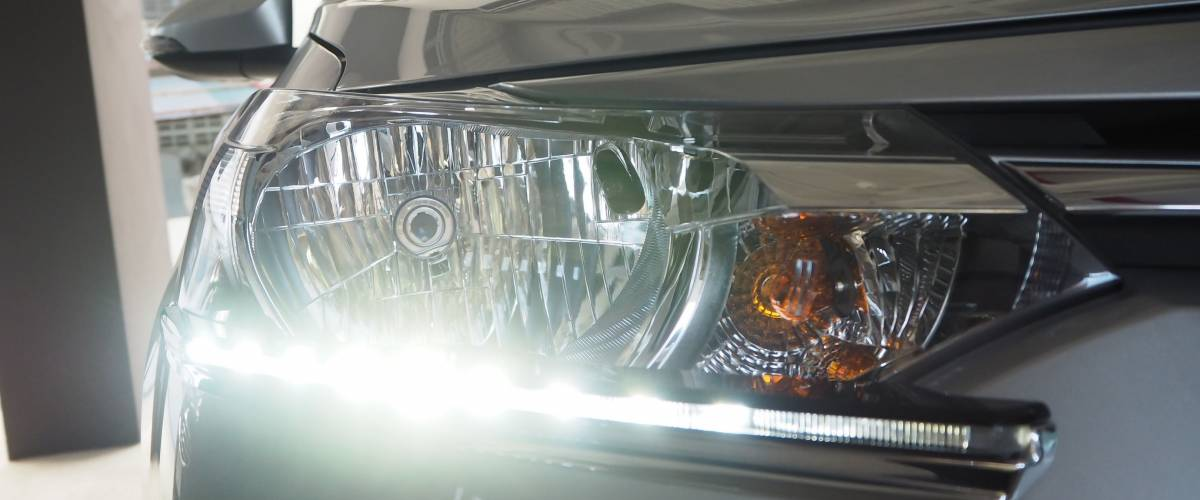 Daytime Running Light. Headlight LED daytime light for car. Lighting standards for cars and safety of motorists.