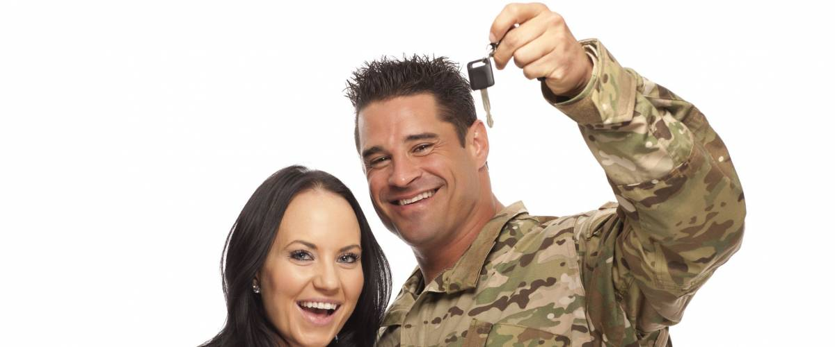Soldier with his wife holding new car key