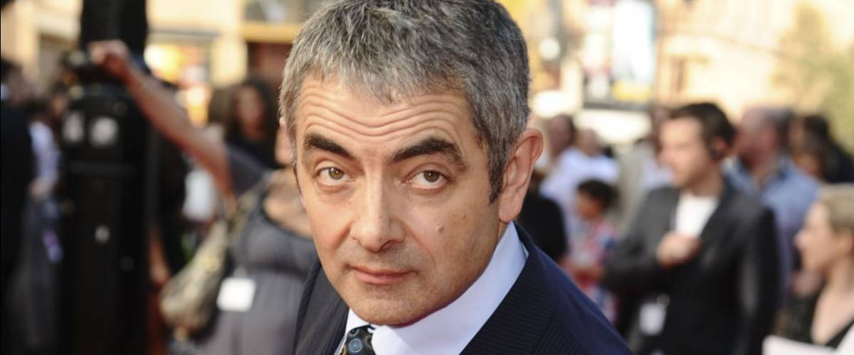 Rowan Atkinson arrives for the