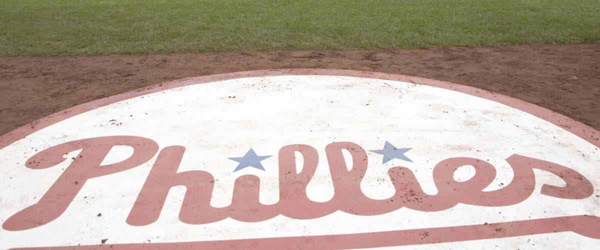 A closeup of Philadelphia Phillies baseball logo on field