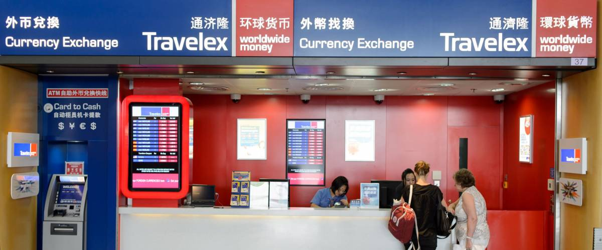 HONG KONG - JUNE 04, 2015: Travelex in Hong Kong Airport. Travelex Group is a foreign exchange company founded by Lloyd Dorfman and headquartered in London