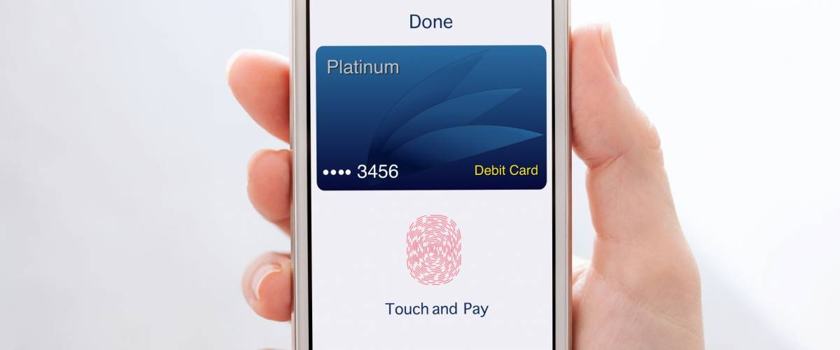 woman hands holding white phone with debit card app touch and pay on screen