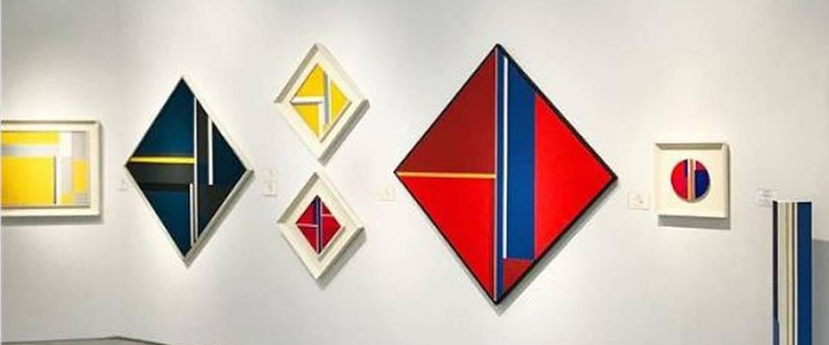 The red Vertical Diamond is a work by artist Ilya Bolotowsky