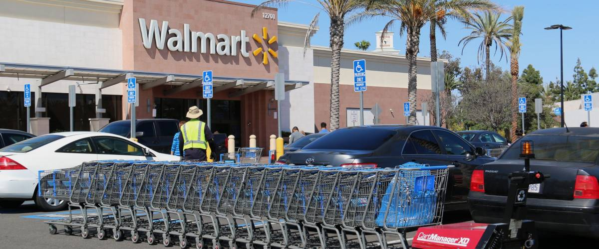 Cerritos, California, USA - April 18, 2016: Carts in parking lot are being pushed by CartManager XD, a shopping cart pusher, to make cart retrieval more efficient and safe.