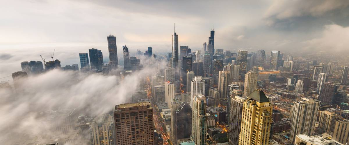 Chicago, Illinois, USA skyline from above with storm clouds and fog rolling in.