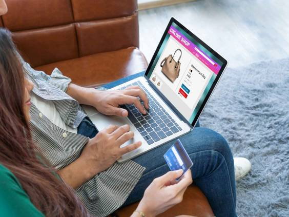 Young couple use credit card for online shopping on laptop