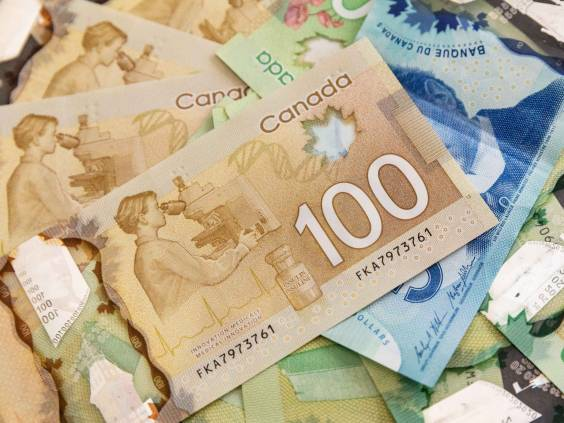 Canadian Dollars, concept of business and finance.Canadian banknotes of different values on a black background