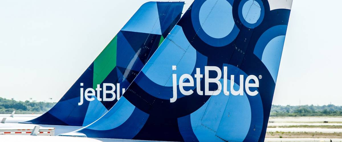 New York, June 22, 2017: Two JetBlue airplanes are parked by the gates awaiting passenger boarding.