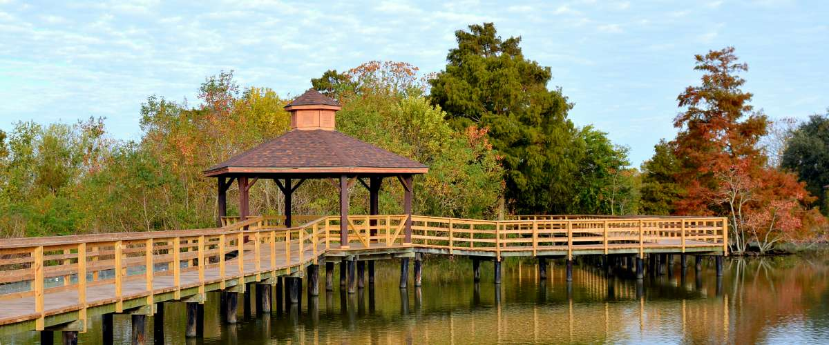 A boardwalk with a gazebo over a southern swamp in Lafreniere Park in Metairie, Louisiana