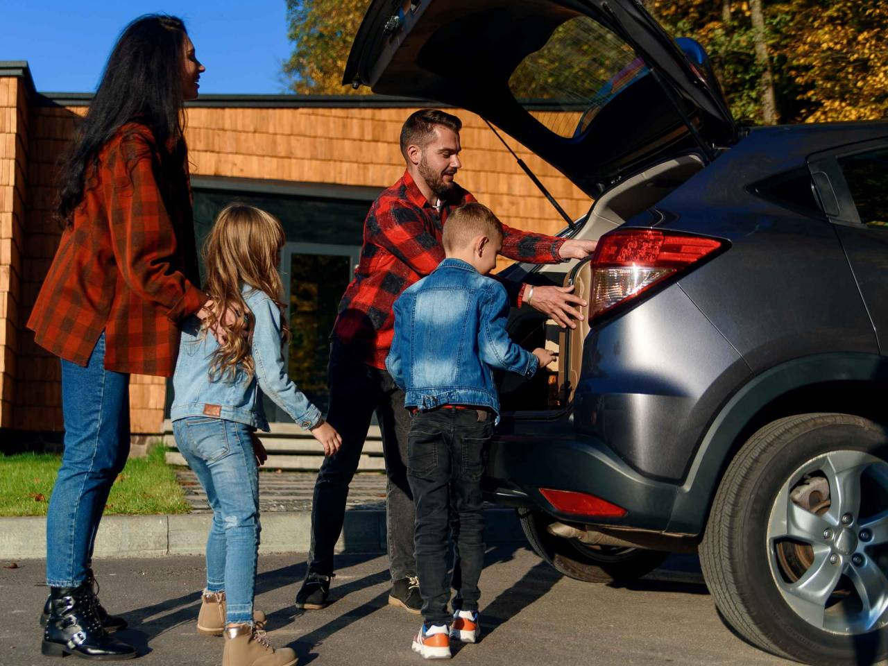 young famly loading car