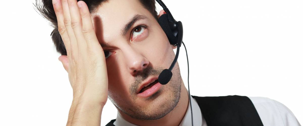 Tired call center operator isolated over white have a headache