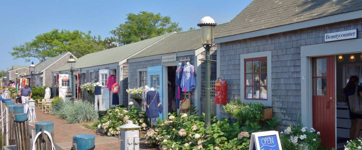 NANTUCKET, MA -4 AUG 2017- Traditional New England buildings and stores on Nantucket Island in Massachusetts. Nantucket is an exclusive preppy summer destination off of Cape Cod near Boston.