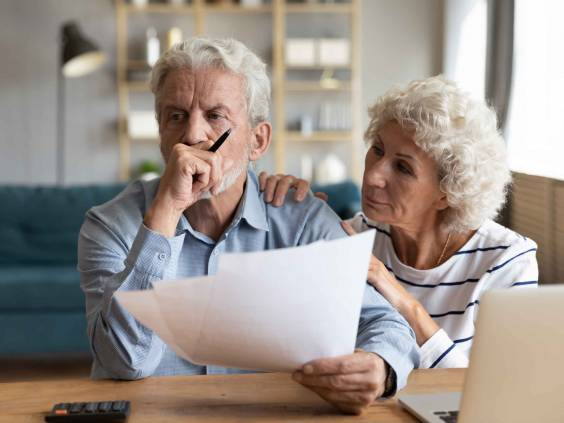 Elderly couple concerned about finances.