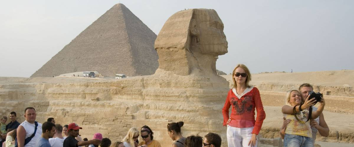 Cairo, Egypt, - October 20, 2015: Many joyful tourists are photographed near the pyramids and the Sphinx in Egypt