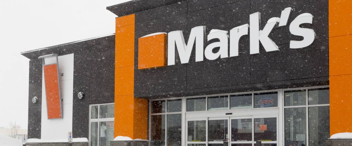OWEN SOUND, CANADA - FEBRUARY 24, 2015 : Mark's Retail Outlet shown here in blizzard weather. The chain was previously known as Mark's Work Wearhouse and is a subsidiary of Canadian Tire