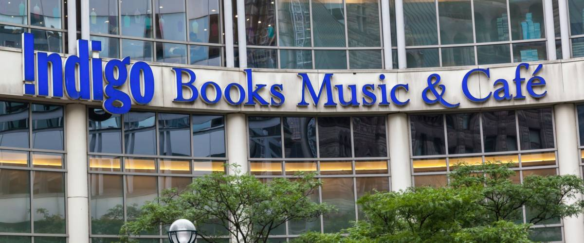 TORONTO, CANADA - JUNE 29, 2017: Store sign- Indigo Books Music & Cafe on the building of Eaton Centre mall in Toronto.