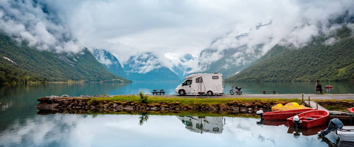 Family vacation travel RV, holiday trip in motorhome, Caravan car Vacation. Beautiful Nature Italy natural landscape Alps.