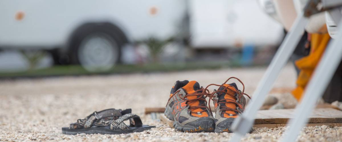 shoes in front of a motorhome on a campground in south europe