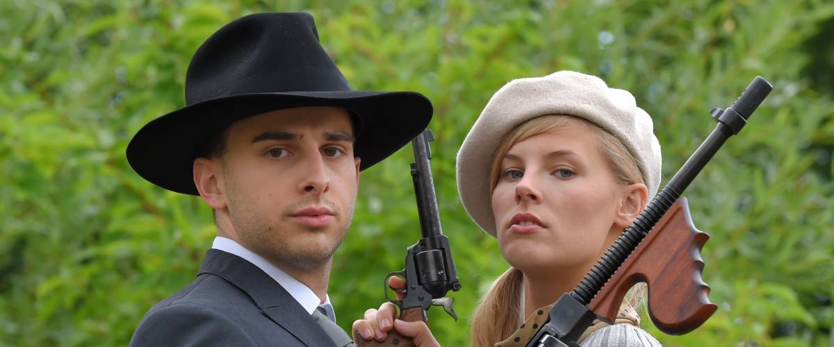 Two models get dressed up in 1930's style vintage fashion clothes and actthe role of the gangster duo Bonnie and Clyde.