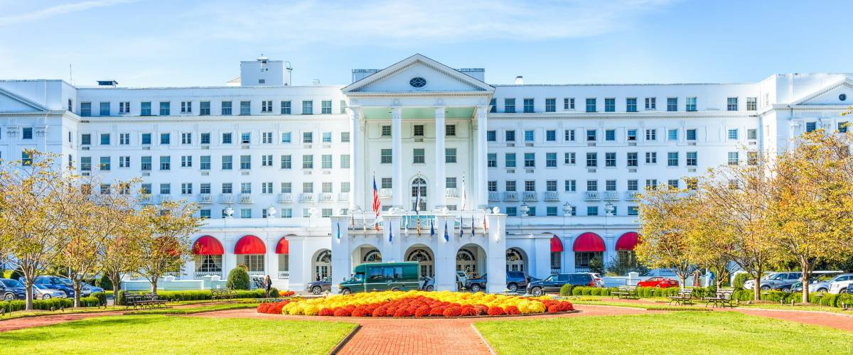 White Sulphur Springs, USA - October 20, 2017: Greenbrier Hotel exterior entrance with landscaped flowers, cars, in West Virginia