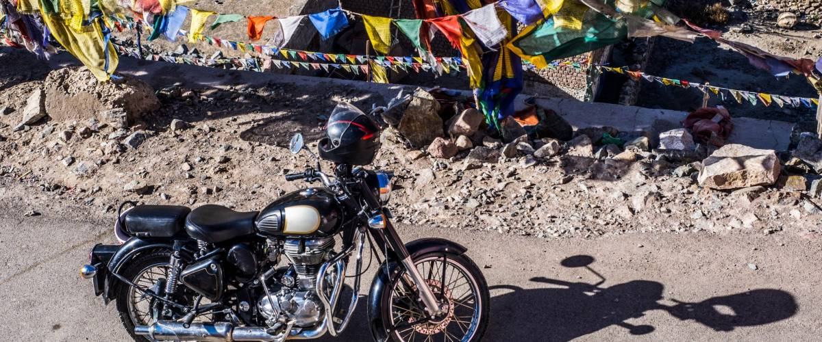 2017 October 15th,Agra India : Black Royal enfield bike with Tibetan flags in Leh city