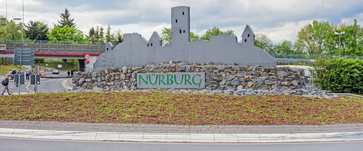 Nurburg, Germany - May 20, 2017: Silhouette of Castle Nurburg near race track Nurburgring at traffic circle
