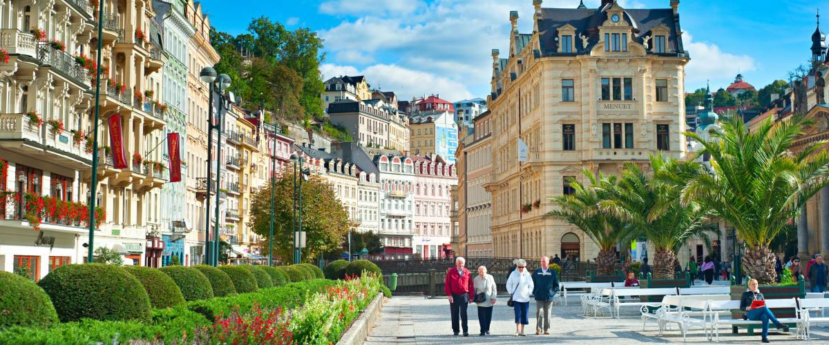 KARLOVY VARY, CZECH REPUBLIC - SEPTEMBER 20, 2012: People walking along Hot springs colonnade in Karlovy Vary.