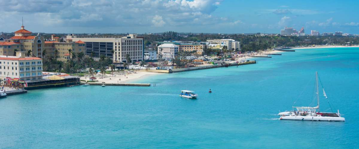 Downtown Nassau, Bahamas on Providence Island with the Nassau port, beach, hotels, and ships
