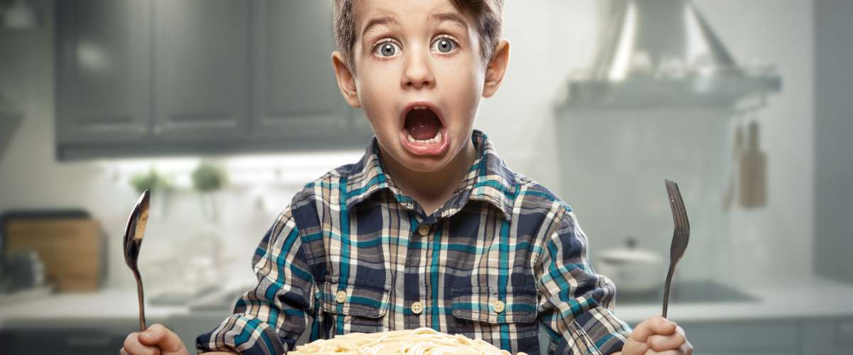 startled young boy with noodles surprised face