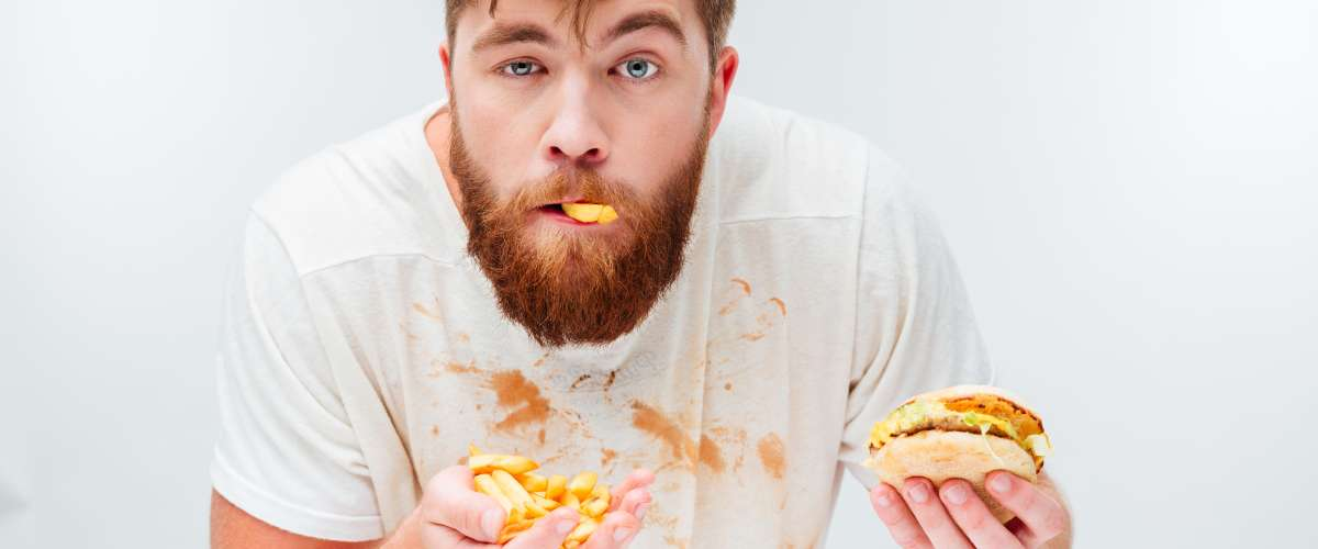 funny hungry bearded man eating messy