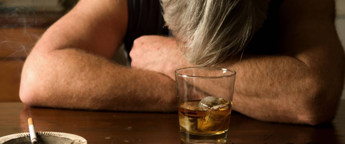 Alcoholism: portrait of a lonely, desperate man