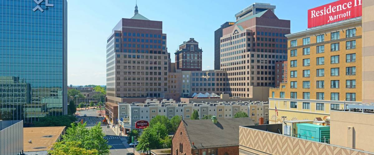 HARTFORD, CT, USA - AUG. 16, 2015: Hartford modern city skyline on Market Street in downtown Hartford, Connecticut, USA.